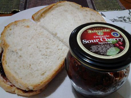 2 slices of bread with organic sour cherry spread