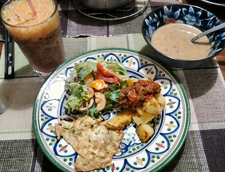 Delicious dinner with baked potato, fresh basil tomato sauce, 1 egg omelet, salad, fruit juice and bean soup