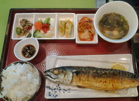 Eating a dish with fried spanish mackerel in a Korean restaurant