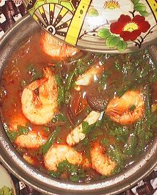A pot delicious and fast tom yum soup made with tom yum paste, fresh coriander and prawns