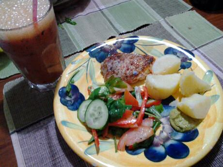 Pan fried pork with mixed salad, boiled potato, coriander hummus and a fruit smoothie