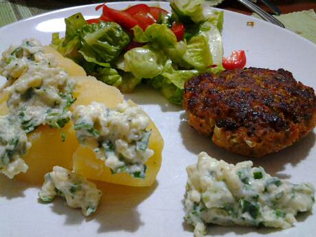 Pork patties recipe served with boiled potatoes, garlic with herbs sauce and a mixed salad with olive oil vinaigrette