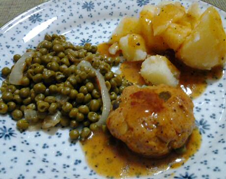 Pork peanut patties served with boiled potato, peas and a quick and easy sauce