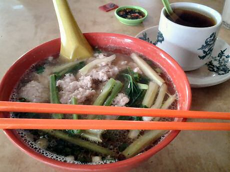Simple pork noodle soup lunch with a cup of tea