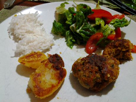 Pork patties with rice, fried potato and mixed salad