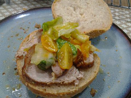 Delicious yet simple pork roast recipe served on a delicious sesame bun with salad and dressing