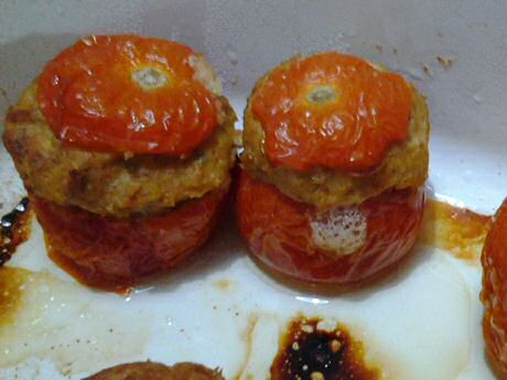 Stuffed tomatoes with pork meat, nuts, olive oil, garlic and spices