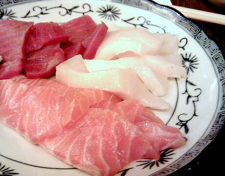 Japanese sushi raw fish: tuna, salmon and monkfish