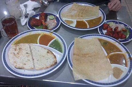 Traditional Indian food:chicken tikka, tandoori chicken, garlic naan and thosai