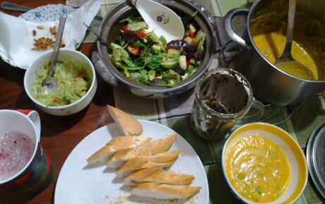 Vegetarian dinner French bread, vegan pumpkin soup, guacamole, tapanade, mixed salad and freshly squized and blended fruit juice